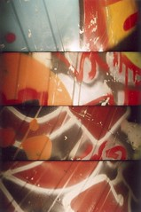 Graffiti - 30Aug09, Paris (France) (]) Tags: blue urban orange blur detail film truck 35mm graffiti blurry xpro lomography supersampler sampler 4 slide super scan bleu 200 analogue 135 sequence 35 ektachrome flou argentique diapositive urbain dtail ekta diapo pellicule squence positif urbandetail dtailurbain comion lomographyslidexpro200