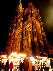 Christmas markets in front of Cathdrale Notre-Dame de Strasbourg (SerenadeS) Tags: christmas france church night cathedral markets noel illuminated strasbourg tall notre dame impressive