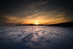 A Race with the Sun (Insight Imaging: John A Ryan Photography) Tags: winter sunset toronto ontario ice lakeerie niagara aficionados portcolborne pentaxk10d justpentax johnaryan mwqio wwwinsightimagingca johnaryanphotography