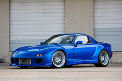 Widebody RB25DET FD RX7 (_jvns) Tags: blue skyline magazine monterey video big paint exterior nissan shot dish suspension interior cusco wheels engine fender swap rig flare brakes motor pearl coverage burnout tuner mazda rims rx7 import lamborghini upgrade rolling rotary jdm intercooler fujita pettit 540 offset kenwood turbocharged drivetrain fd boosted greddy nismo widebody hre nardi murcialago defi 25l rotora dsport rb25det lp640 walbro tunerlifestyletvcom
