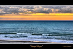 Orange Horizon (NIKON 505) Tags: ocean sunset sea sky seascape storm color slr beach water clouds digital myrtlebeach coast sand nikon colorful cloudy stormy shore beaches tropical nikkor dslr tropics d90 nikondslr justclouds nikond90 capturenx2