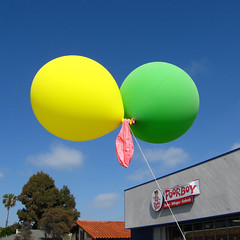 Poor Pink deflated balloon by Poorboy restaurant ~ Still hanging~ ;D (Dom Guillochon) Tags: california pink blue trees usa green art beach colors yellow clouds balloons unitedstates sandiego bluesky beachlife pb palmtrees hanging pacificbeach poorboy californiacoast grandavenue stillhanging
