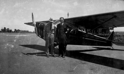 Two men and light plane