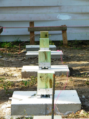 Posts sitting on footings