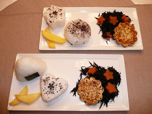Handmade Onigiri with stewed hijiki seaweed, carrots and fried tofu
