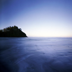 the floating island (manyfires) Tags: ocean blue sea film oregon sunrise square coast pacificocean pacificnorthwest zero2000 neskowin zeroimage palabra proposalrock autaut itsbeenawhilesinceivepostedapinhole pinholebb