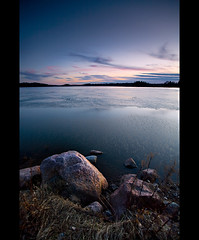 From ice into water (Nina_999) Tags: sunset lake ice water clouds canon finland spring rocks wind shoreline melt ripples eos5d supershot mywinners goldcollection gwain