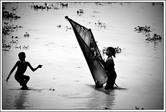 Amphibian childhood [..Dhamrai, Bangladesh..] (Catch the dream) Tags: boy bw net water girl childhood rural children fishing village action bongo posture bengal bangladesh bangla bengali villagepeople fishingnet bangladeshi shilhouette bangali dhamrai gettyimagesbangladeshq2