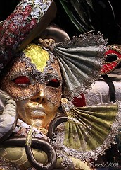 Mask of an Angel (livininfrostytown) Tags: carnival venice costumes italy woman holiday history window beautiful glitter angel shopping store amazing paint mask famous celebration event fabric carnivale fans february 2009 windowshopping 2011 frostytown flickrchallengegroup flickrchallengewinner charmedimpressions