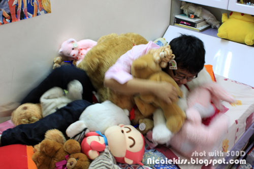 getting up from a bed of teddies