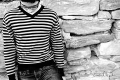 (emanuel viziteu) Tags: portrait bw white black lines wall glasses stones tag jeans v pietre portret newtag ochelari bluza blugi tacere dungi albcunegru
