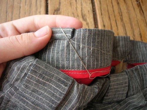 A few extra minutes handsewing results in a sturdy, lovely-looking belt carrier detail.