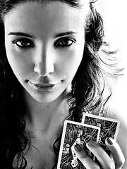Poker Face (AnnuskA  - AnnA Theodora) Tags: face cards eyes fingers poker ojos backlit cartas rostro pokerface 200faves 3000v120f curlyblackhair theselastdayshavebeenthehottestinthelast30years itsridiculouslyhot decidednottocleanskinflawinthisphoto elmismoclimaclidohayaca