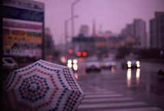 (mark justin harvey) Tags: film rain umbrella 50mm fuji slide olympus 400 southkorea expired e6 zuiko bundang sensia om2n 50mmf12 autaut