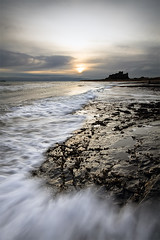 Fifteen Minutes of ZZZs (jasontheaker) Tags: ocean sunset castle dawn movement north wave northumberland geology sanddunes bambrough rockssea jasontheaker wynding lookclose otherphotographers