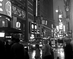 Night in the City (musicmuse_ca) Tags: street nyc bw 15fav rain night manhattan timessquare jonimitchell sr42 nightinthecity