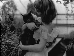 Rose with a cat (Emily Savill) Tags: b bw white house black green film girl rose cat 35mm canon 1 kitten w pussy kitty f1 greenhouse f mm 35 ultra artista