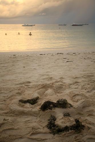 a bikini sandcastle