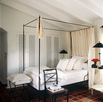 White bedroom: Four-poster + terracotta tiles, by designer Mimmi O'Connell