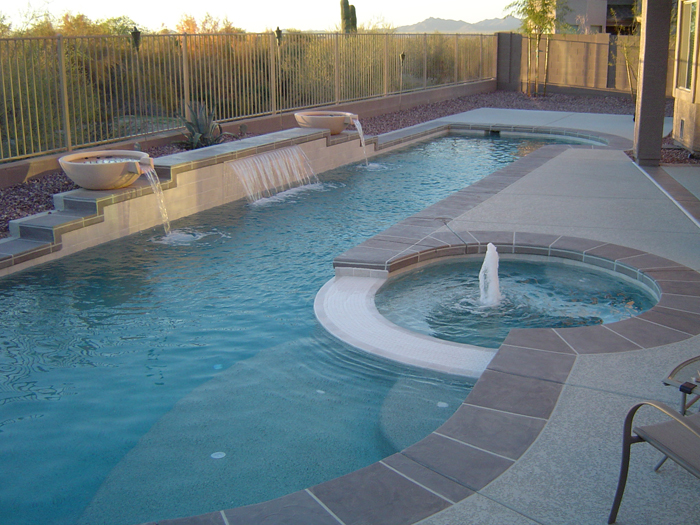 Good waterfall on the swimming pool designs. Equipped with a small spa pool  700 x 525 · 383 kB · jpeg