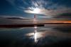 K20D0171 (Bob West) Tags: longexposure nightphotography moon lighthouse night clouds lakeerie greatlakes moonlight nightshots startrails erieau southwestontario bobwest sigma24mm k20d eastlighthouseerieau gaju2810
