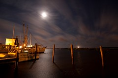Southport Harbor ([nosamk] KMason photography) Tags: ocean longexposure moon lighthouse seascape water night clouds port river stars landscape boats harbor nc fishing shadows wind fear tripod northcarolina atlantic cape southport gitzo waterway constellation oakisland scorpius diamondcity caswellbeach arcatech tokinaatx116prodx gt2531