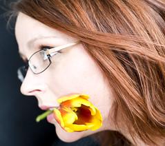 Exhale -- Aug. 14, 2009 (Jenn Long) Tags: red portrait flower self hair glasses teeth profile tulip bloom nikkor50mm118d nikond700 nofear365
