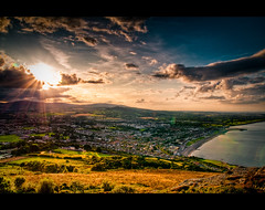The place where I live (Gerg) Tags: blue ireland sunset summer sky sun sunlight white mountain green beautiful beauty grass yellow rock clouds landscape coast town nice good awesome explore lensflare capture hdr bray canon500d blueribbonwinner photomatix explored sigma1770mm abigfave sigma1770mmf2845dcmacro flickrphotoaward platinumheartaward goldenart saariysqualitypictures