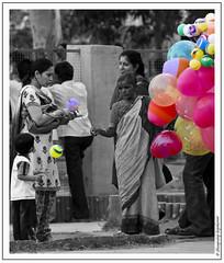 The Serious and The Curious (shivan) Tags: people color sad sale kota rajastan bundi selectivecoloring 40d chambalgardens gubbarewali
