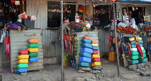 A spectrum of jerry cans and umbrellas