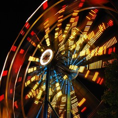Big Wheel (StGrundy) Tags: longexposure carnival blue atlanta red summer usa motion blur colors yellow night contrast dark georgia lights moving lowlight nikon ride nightshot unitedstates south spin roswell wideangle explore southern exposition squareformat ferriswheel rides bigwheel 2008 rotating amusements turning explored d80 expowheel mywinners focallength26mm peachtreerides nikkor1855mmf3556gvr aperturef42 roswellmall exposure06sec
