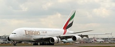 Emirates A380 at Heathrow Airport (C.S Chaulk) Tags: uk london plane gold big airport dubai heathrow hugh aircraft touch down terminal aeroplane east landing emirates engines airline airbus a380 worlds gateway arrival reverse middle airlines aeroport arrived biggest airliner jumbo avion lhr winglets egll a380800 a388