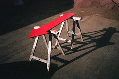 (George Pollard) Tags: trestle shadow red horse brown yard painting sand northampton fuji superia saturday olympus direction arrow pointing 800 mhs xa3 miltonstreet modernhomesales aggregate watchingpaintdry snappysnaps diystore 210209 shootingatthewrongspeed onestopdiy