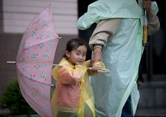 Rainy time in Pyongyang North Korea (Eric Lafforgue) Tags: pictures girl smile rain weather umbrella photo kid war asia child picture korea kimjongil asie coree northkorea pyongyang dprk coreadelnorte kimilsung 5863 nordkorea lafforgue    coredunord coreadelnord  northcorea coreedunord  insidenorthkorea  rpdc  coriadonorte  kimjongun coreiadonorte