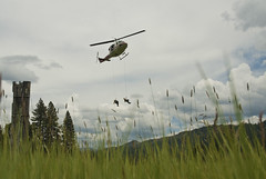 Into The Green (RexAriel) Tags: helicopter ship flight fly aviation rotor rappel rappelling wild fire green grass clouds sky weather work forest woods mountains trees service fighter usfs nikon digital d200 rex sundstrom tahoe national helitack