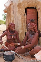 Himba women cooking in front of their hut in northern Namibia (jitenshaman) Tags: africa people african culture tribal safari afrika tribe ethnic namibia tribo himba primitive afrique ethnology tribu namibie tribus ethnie davestamboulis