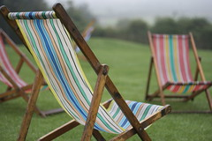 Taking a break... s0ulsurfing has left the building (s0ulsurfing) Tags: wedding summer vacation england holiday green english grass rain focus deckchair dof stripes empty away august gone reception rainy getty raining 2009 dull deckchairs s0ulsurfing