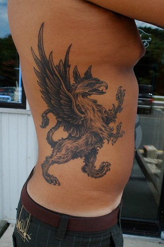 griffin tattoo by Independent Tattoo. black and gray tattoo by Matthew Amey