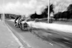motion sickness (Patrick Brosset) Tags: road street blackandwhite bw white motion black blur bicycle sport speed fast line motionblur filter cycle antibes juanlespins neutraldensityfilter greyfilter filtregris