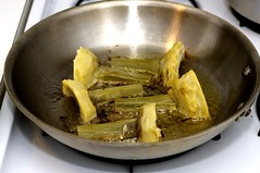 browning the artichokes