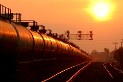 Harbor Train Sunset (greenthumb_38) Tags: railroad sunset orange sun train golden explore signal fullerton goldenhour glint tankers tankcar tankcars signalbridge explored glowingrails jeffreybass