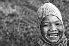 Happy child running (afromemy) Tags: portrait blackandwhite bw india white black smile children tribal retratos sorriso tribe panning bianco ritratto nero bianconero bambino trib tribale arunachalpradesh tirap wancho artofimages