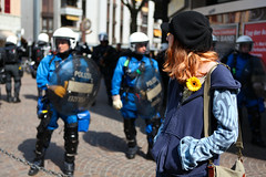 Girl with a yellow flower during May 1st riots in Zurich