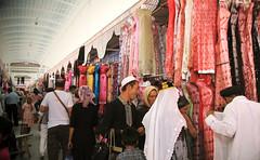 kashgar sunday market (Xuan Che) Tags: 2005 life china street city travel summer portrait west market hijab culture august clothes oasis xinjiang silkroad kashgar uyghur bazaar tradition centralasia trade canonixus400 islamic