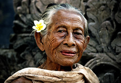 Indonesia, Bali. Portrait of a beautiful elderly balinese lady. (Ania Blazejewska) Tags: travel portrait people bali woman flower beauty indonesia temple women asia elderly age wrinkles wrinkle balinese balinesewomen sangsit purabeji earthasia mygearandmepremium mygearandmebronze