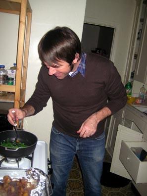 Brian making dinner