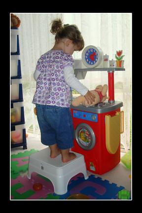 14-2-09 emma puts pooh bear on the stove 4x6 72dpi