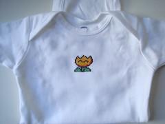 fire flower onesie (benjibot) Tags: clothing crossstitch crafts videogames snes onesie supermarioworld