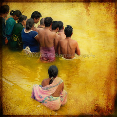Golden Prayers for L'Aquila (designldg) Tags: people italy orange woman india man water dedication yellow gold amber hands colours peace emotion prayer religion panasonic human silence soul devotion varanasi spiritual shanti brotherhood hindu hinduism kashi ganga aum ganges ghats benaras uttarpradesh   indiasong dmcfz18 hourofthesoul