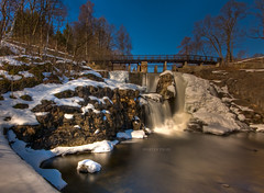 In memory (mortenprom) Tags: wood longexposure bridge blue winter light brown white snow plant color reflection tree ice nature wet water yellow oslo norway stone architecture forest fence river landscape concrete golden march norge woodwork waterfall stream day skandinavien gray norwegen sunny wideangle rails granite noruega scandinavia 2009 noorwegen noreg sigma1020mm lysaker skandinavia lysakerelven nd1000 abigfave nd30 bw110 canoneos40d platinumheartawards nd1000x goldstaraward naturaldensityfilter mortenprom